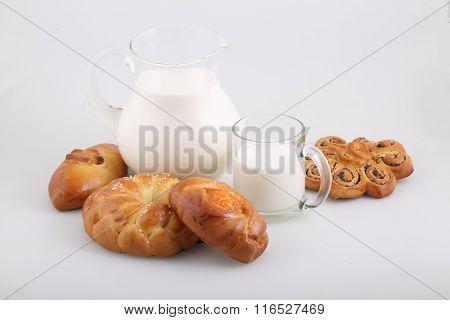 Milk In A Transparent Jug And Buns