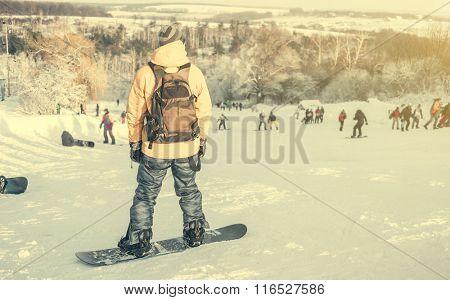 man on snowboard on snowhill
