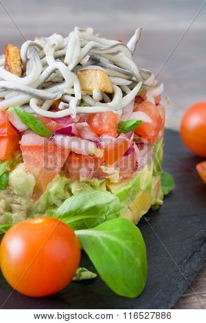 Vegetables and baby eel or elver tartar