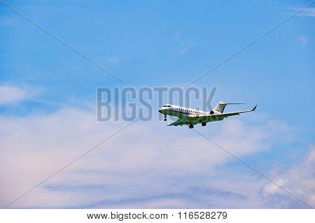HONG KONG - JUNE 04, 2015: The Bombardier Global Express aircraft landing at Hong Kong airport. The Bombardier Global Express is a large cabin, ultra long range business jet.