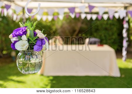 Decorations of flowers for the wedding ceremony. Close-up.