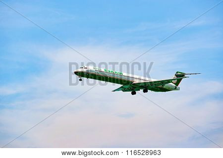 HONG KONG - JUNE 04, 2015: MD-90 landing at Hong Kong airport. The McDonnell Douglas MD-90 is a twin-engine, short- to medium-range, single-aisle commercial jet airliner