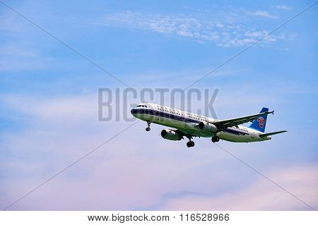 HONG KONG - JUNE 04, 2015: China Southern Airlines aircraft landing at Hong Kong airport. China Southern Airlines Company Limited is an airline headquartered in Baiyun District, Guangzhou.