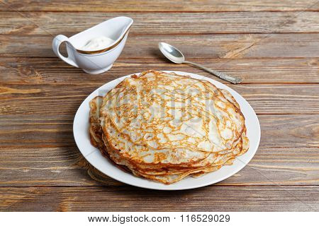 Pancakes On The Dish And Sour Cream