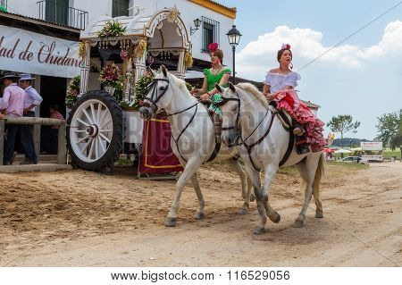El ROCIO ANDALUCIA SPAIN - MAY 22: Young girls horsewomen on horseback passing through the village. The rest of the romeriya after the transition. 2015 It is one of the most famous pilgrimage of Spain. This pilgrimage passes from the 15th century.