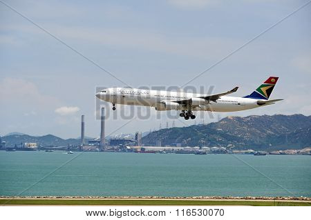 HONG KONG - JUNE 04, 2015: South African Airways aircraft landing at Hong Kong airport. South African Airways (SAA) is the national flag carrier and largest airline of South Africa