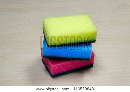 Photo of different colored Cleaning sponges on desk