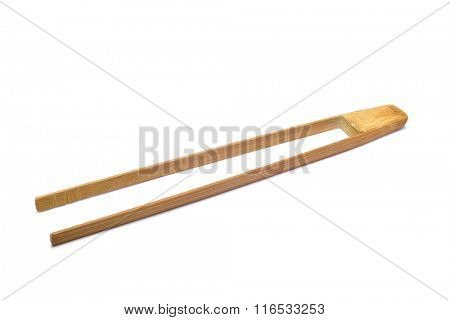 a pair of new bamboo tongs on a white background
