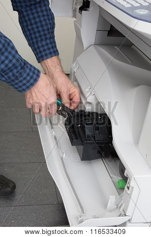 Repairing A Printer In A Bright Office At Work