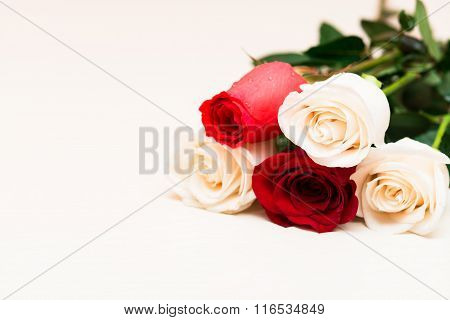 Red And White Roses On A Light Wooden Background. Women' S Day, Valentines Day, Mothers Day