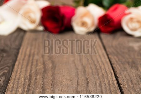 Wooden Baclground With Red And White Blured Roses. Women' S Day, Valentines Day, Mothers Day.