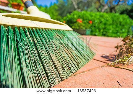 Green Broom On The Floor