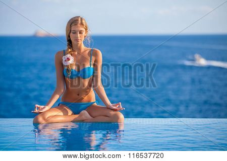 summer vacation or holiday yoga woman
