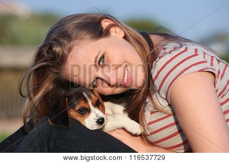girl with pet puppy dog