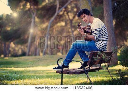 musician practicing  playing guitar