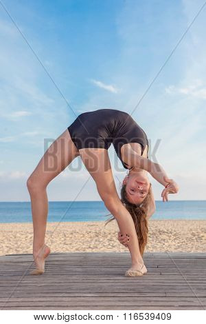 flexible gymnast in dance pose