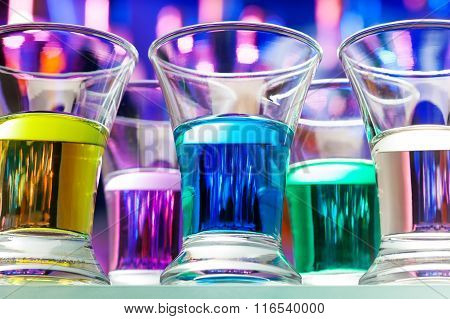 Set of color alcohol drinks in shots from below