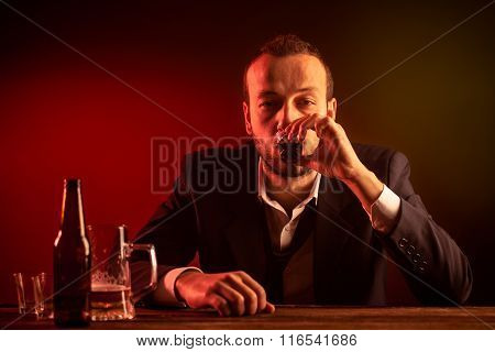 Businessman Drinking a Shot