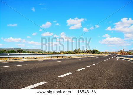 Country Road Under A Blue Sky