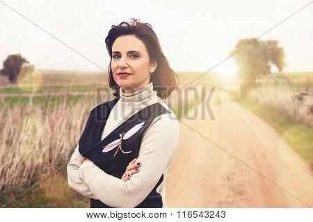 Crossed arms woman portrait.