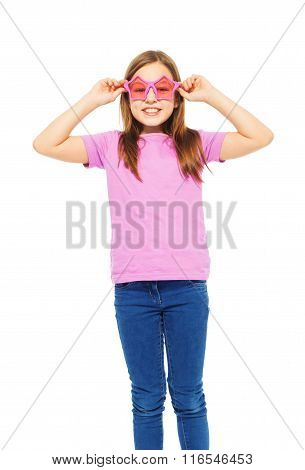 Pretty girl wearing funny pink glasses and t-shirt