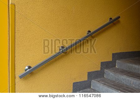 Metal Railing On A Yellow Wall. Architecture