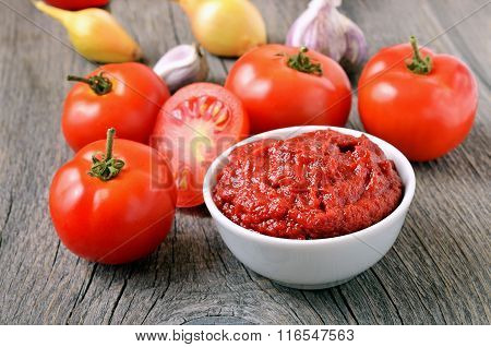 Homemade Tomato Sauce In A White Bowl And Fresh Tomatoes