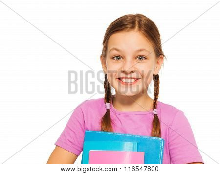 Happy positive pupil with books isolated on white
