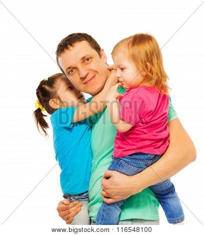 Father holds two daughters in his arms