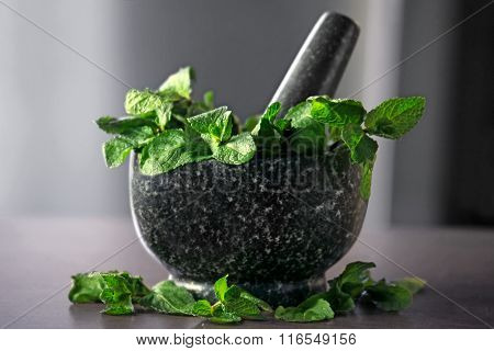 Mortar And Mint Leaves