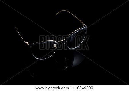 Cat eyes shaped retro glasses on black background.
