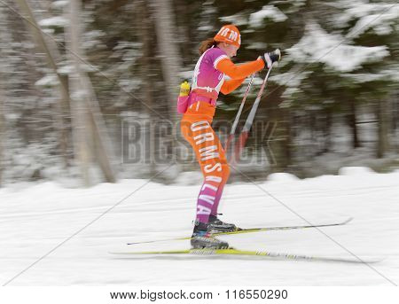 Side View Of Rapid Colorful Cross Country Skiing Girl