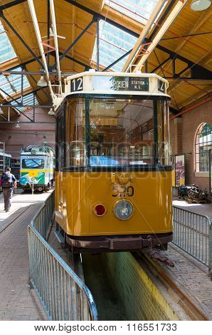 ARNHEM NETHERLANDS - JULY 26 2015: Vintage tram in a depot in the Netherlands Open Air museum. The museum shows the Dutch history from an everyday perspective