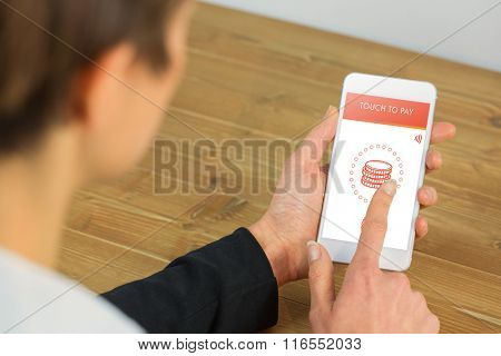 Businesswoman using phone at desk against web