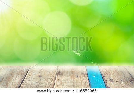 Nature Leaf Bokeh With Sun Light On Old Empty Wood Table Background.