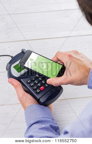 Web against man holding credit card reader and mobile phone