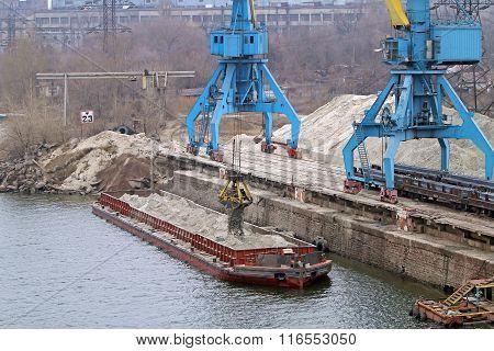 Job Cargo Port. Port Cranes Unloading Sand Barge