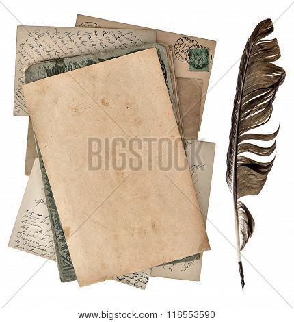 Grungy paper page antique postcards and vintage ink pen isolated on white background