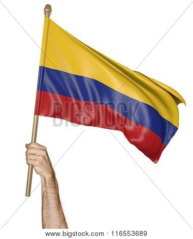 Hand proudly waving the national flag of Colombia