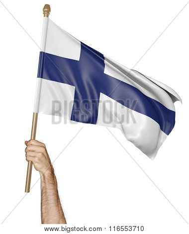 Hand proudly waving the national flag of Finland