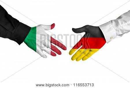 Italy and Germany leaders shaking hands on a deal agreement