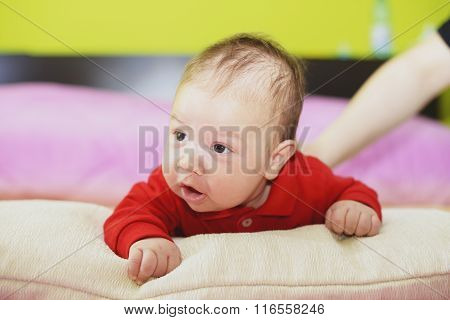 Newborn Baby Lying On His Stomach And Looking Forward