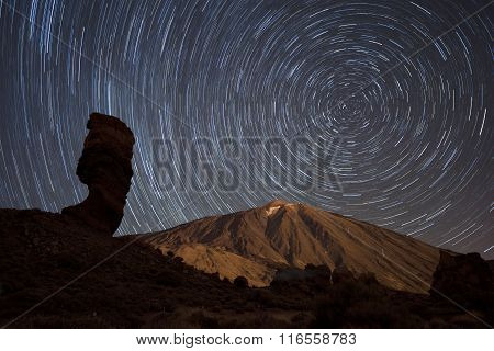Star trails over Teide volcano in Teide national park Tenerife Canary Islands Spain.