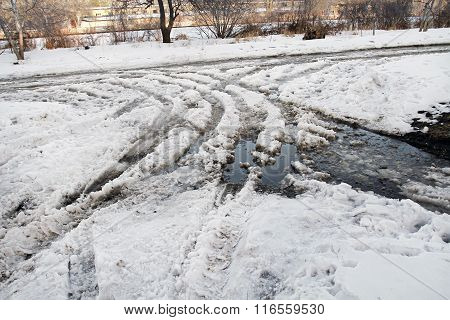 Traces Of Cars On The Melting Snow. Utilities Do Not Have Time To Clear The Road From The Melting Of