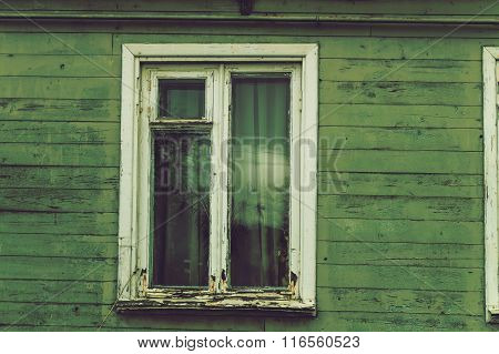 The old dilapidated window frame house