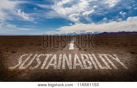 Sustainability written on desert road