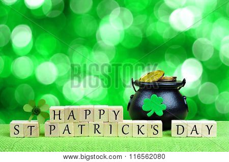 Happy St Patricks Day blocks with Pot-of-Gold over twinkling green