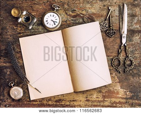Open Book And Antique Writing Tools. Vintage Style