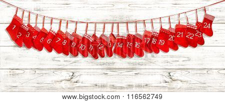 Advent Calendar. Red Stocking On Bright Wooden Background