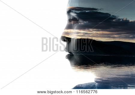 Double exposure portrait of a woman